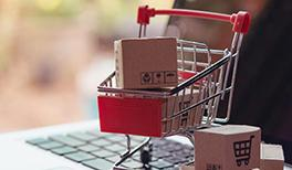 Shopping cart on top of laptop depicting online shopping and eCommerce