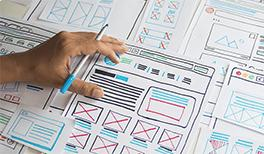 Webmaster choosing website wireframe designs for his company's website